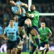 Highlanders' Patrick Osborne, right, and Waratahs' Bernard Foley clash as they leap high to take the ball during their Super Rugby Semi Final in Sydney, Australia, Saturday, June 27, 2015. (AP Photo/Rob Griffith)