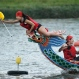 The boat captain grabs her finish line flag during a traditional Chinese Dragon Boat race in Taipei, Taiwan, Friday, June 19, 2015. Dragon boat races are in remembrance of Chu Yuan, an ancient Chinese scholar-statesman, who drowned in 277 B.C. while denouncing government corruption. (AP Photo/Wally Santana)