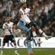 Tottenham Hotspur player Mousa Dembele, top, and Sydney F.C player Mickael Tavares leap to head the ball during their friendly match in Sydney, Australia, Saturday, May 30, 2015. (AP Photo/Glenn Nicholls)