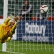 Serbia's goalkeeper Predrag Rajkovic dives as he attempts to save a shot on goal during a penalty shoot out against the USA during their U20 soccer World Cup quarterfinal game in Auckland, New Zealand, Sunday, June 14, 2015. (AP Photo/David Rowland)