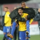 Brazil's Danilo carries teammate Jaja as they celebrate following their U20 soccer World Cup semifinal game against Senegal in Christchurch, New Zealand, Wednesday, June 17, 2015. Brazil defeated Senegal 5-0. (AP Photo/Ross Setford)