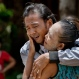 In this May 16, 2015 photo, former slave fisherman Myint Naing and his mother, Khin Than, cry as they are reunited after 22 years at their village in Mon State, Myanmar. Myint, 40, is among hundreds of former slave fishermen who returned to Myanmar following an Associated Press investigation into the use of forced labor in Southeast Asia's seafood industry. (AP Photo/Gemunu Amarasinghe)