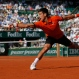 Serbia's Novak Djokovic stretches to return the ball to Britain's Andy Murray, right, during their semifinal match of the French Open tennis tournament at the Roland Garros stadium, Friday, June 5, 2015 in Paris, France. (AP Photo/Francois Mori)