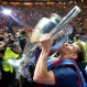 Barcelona's Lionel Messi kisses the trophy after his team won 3-1 the Champions League final soccer match between Juventus Turin and FC Barcelona at the Olympic stadium in Berlin Saturday, June 6, 2015. (AP Photo/Martin Meissner)