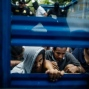 """In this May 28, 2015 photo, suspected members of the 18th Street gang are transported in a livestock trailer to""""bartolinas"""", the Spanish word for holding cells, in Panchimalco, El Salvador. """"We can go in and arrest 50 gang members and 50 more will take their places,"""" says assistant national police chief, who believes nothing will change unless the country addresses problems of poverty and a lack of opportunity for young people. (AP Photo/Manu Brabo)"""