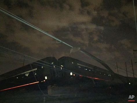 An Amtrak train crashed Tuesday, May 12, 2015, in Philadelphia. Train 188 was traveling from Washington to New York City. (AP Photo/Paul Cheung)