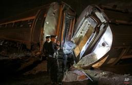 Emergency personnel work the scene of an Amtrak train wreck in Philadelphia, May 12, 2015. (AP Photo/Joseph Kaczmarek)