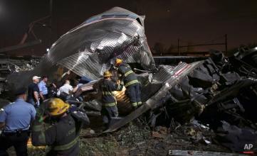 Emergency personnel work the scene of an Amtrak train wreck, Tuesday, May 12, 2015, in Philadelphia. (AP Photo/Joseph Kaczmarek)