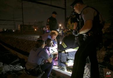 Emergency personnel work the scene of an Amtrak train wreck, Tuesday, May 12, 2015, in Philadelphia. (AP Photo/ Joseph Kaczmarek)