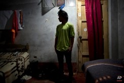 In this March 14, 2015 photo, Mardonio Borda, 19, poses a picture during an interview with The Associated Press, in La Mar, province of Ayacucho, Peru. A native Quechua with broken Spanish and a sixth-grade education, Borda is among untold hundreds of cocaine backpackers who make the difficult and dangerous trek up Andean mountain paths first carved by their pre-Incan ancestors. (AP Photo/Rodrigo Abd)