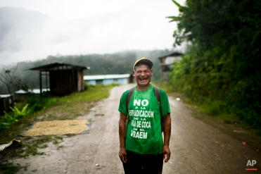 """In this March 15, 2015 photo, Fortunato Farfan, laughs while posing for the picture in La Mar, province of Ayacucho, Peru. Fortunato's is wearing a T-shirt with a phrase that reads in Spanish: """"No to coca eradication in the Vraem"""". Not a single fully paved road rises out of the Apurimac, Ene and Mantauro river valley (VRAEM), from which cocaine also departs via small plane to neighboring Bolivia. (AP Photo/Rodrigo Abd)"""