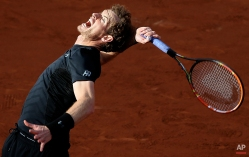 Britain's Andy Murray serves the ball to Argentina's Facundo Arguello during their first round match of the French Open tennis tournament at the Roland Garros stadium, Monday, May 25, 2015, Paris, France. Murray won 6-3, 6-3, 6-1. (AP Photo/David Vincent)