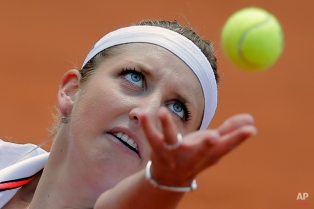 Timea Bacsinszky of Switzerland serves in the third round match of the French Open tennis tournament against Madison Keys of the U.S. at the Roland Garros stadium, Paris, France, Saturday, May 30, 2015. Bacsinszky won in two sets 6-4, 6-2. (AP Photo/Christophe Ena)