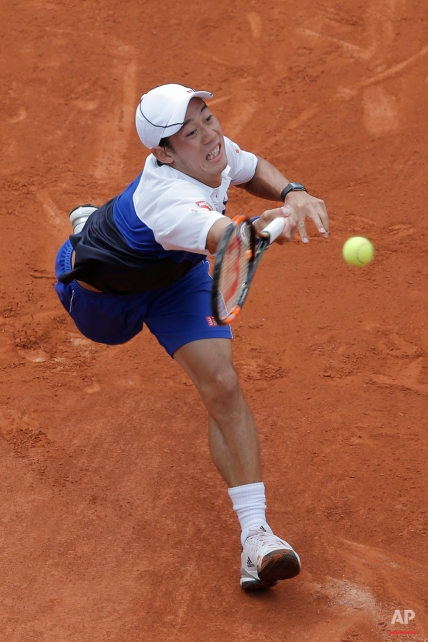 Japan's Kei Nishikori returns in the first round match of the French Open tennis tournament against Paul-Henri Mathieu of France at the Roland Garros stadium, Paris, France, Sunday, May 24, 2015. (AP Photo/Christophe Ena)