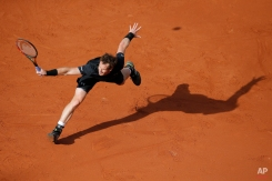Britain's Andy Murray returns in the first round match of the French Open tennis tournament against Argentina's Facundo Arguello at the Roland Garros stadium, Paris, France, Monday, May 25, 2015. (AP Photo/Christophe Ena)