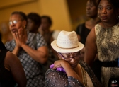 Mourners gather before the funeral service for Ethel Lance, 70, the first one for the nine people killed in the shooting at Emanuel AME Church, Thursday, June 25, 2015, in North Charleston, S.C. (AP Photo/David Goldman)