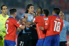 Uruguay's Edinson Cavani, center left, argues with Chile's Gonzalo Jara, 2nd right, during a Copa America quarterfinal soccer match at the National Stadium in Santiago, Chile, Wednesday, June 24, 2015. Cavani was expelled from the game after receiving a double yellow card. Chile won the match 1-0 (AP Photo/Ricardo Mazalan)
