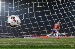 Chile's Alexis Sanchez celebrates after scoring the winning penalty kick against Argentina during the Copa America final soccer match at the National Stadium in Santiago, Chile, Saturday, July 4, 2015. Chile became Copa America champions for the first time after it defeated Argentina in a penalty shootout. (AP Photo/Ricardo Mazalan)