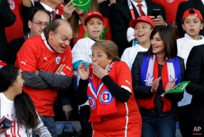 Chile's President Michelle Bachelet, center, shares a laugh before the Copa America final soccer match between Chile and Argentina at the National Stadium in Santiago, Chile, Saturday, July 4, 2015. (AP Photo/Natacha Pisarenko)