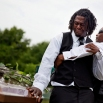 Brandon Risher, left, is pulled away by a friend as he cries over the casket of his grandmother, Ethel Lance, following her burial service, Thursday, June 25, 2015, in Charleston, S.C. Lance was one of the nine people killed in the shooting at Emanuel AME Church in Charleston. (AP Photo/David Goldman)