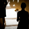 A woman, right, leaves a memorial service for the victims of the shooting Wednesday at Emanuel AME Church with two roses, Friday, June 19, 2015, in Charleston, S.C. Dylann Roof is accused of killing nine people inside the church. (AP Photo/Stephen B. Morton)