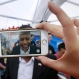 Republican presidential candidate Dr. Ben Carson speaks to supporter making a video on a cell phone during a fundraiser for U.S. Sen. Joni Ernst, R-Iowa, in Boone, Iowa on Saturday, June 6, 2015. (AP Photo/Charlie Neibergall)