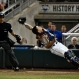 Virginia catcher Matt Thaiss loses his footing while catching a fly ball by Vanderbilt outfielder Jeren Kendall during the sixth inning of Game 1 of the best-of-three NCAA baseball College World Series finals at TD Ameritrade Park in Omaha, Neb., Monday, June 22, 2015. (AP Photo/Mike Theiler)