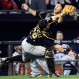 Pittsburgh Pirates catcher Francisco Cervelli (29) and third baseman Jung Ho Kang, right, collide as Cervelli catches a popup by Chicago White Sox's Geovany Soto during the seventh inning of a baseball game, Wednesday, June 17, 2015, in Chicago. (AP Photo/David Banks)