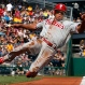 Philadelphia Phillies' Ben Revere scores from third on an infield ground out by Chase Utley in the first inning of a baseball game in Pittsburgh, Saturday, June 13, 2015. (AP Photo/Gene J. Puskar)