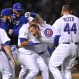 Chicago Cubs' Chris Denorfia is carried by teammates after hitting the game-winning sacrifice fly ball to score Matt Szcur during the 10th inning of a baseball game to defeat the Los Angeles Dodgers 1-0 Tuesday, June 23, 2015, in Chicago. (AP Photo/Paul Beaty)