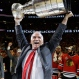 Chicago Blackhawksí head coach Joel Quenneville hoists the Stanley Cup after defeating the Tampa Bay Lightning in Game 6 of the NHL hockey Stanley Cup Final series on Wednesday, June 10, 2015, in Chicago. The Blackhawks defeated the Lightning 2-0 to win the series 4-2. (AP Photo/Nam Y. Huh)