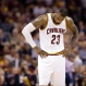 Cleveland Cavaliers forward LeBron James (23) hangs his head during the second half of Game 6 of basketball's NBA Finals against the Golden State Warriors in Cleveland, Tuesday, June 16, 2015. (AP Photo/Tony Dejak)