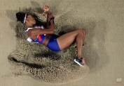 Britain's Shara Proctor lands in the sand as she competes in the women's long jump final at the World Athletics Championships at the Bird's Nest stadium in Beijing, Friday, Aug. 28, 2015. (AP Photo/Wong Maye-E)