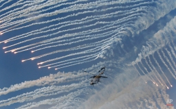 South Korean army's Surion helicopter fires flare shells during the South Korea-U.S. joint military live-fire drills at Seungjin Fire Training Field in Pocheon, South Korea, near the border with North Korea, Friday, Aug. 28, 2015. The South Korean and U.S. soldiers held the combined live fire drill on Friday to display combined firing capabilities between South Korea and the U.S. militaries, showing that they are prepared to defend South Korea against North Korea's possible attack or provocations. (AP Photo/Ahn Young-joon)