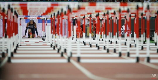 France's Pascal Martinot-Lagarde waits to run in a men's 110m hurdles semifinal at the World Athletics Championships at the Bird's Nest stadium in Beijing, Thursday, Aug. 27, 2015. (AP Photo/David J. Phillip)