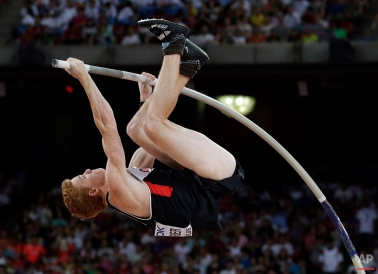 Canada's Shawnacy Barber competes in the men's pole vault final at the World Athletics Championships at the Bird's Nest stadium in Beijing, Monday, Aug. 24, 2015. (AP Photo/Andy Wong)
