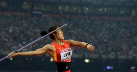 China's Lyu Huihui in action on her way to taking the silver medal in the women's javelin final at the World Athletics Championships at the Bird's Nest stadium in Beijing, Sunday, Aug. 30, 2015. (AP Photo/Lee Jin-man)