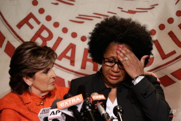 Attorney Gloria Allred, left, comforts Charlotte Fox, as she reads a statement during a news conference Thursday, Aug. 20, 2015, in New York. Fox alleges that Bill Cosby sexually assaulted her. (AP Photo/Mary Altaffer)