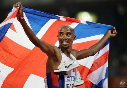 Britain's Mo Farah celebrates winning the men's 5000m final at the World Athletics Championships at the Bird's Nest stadium in Beijing, Saturday, Aug. 29, 2015. (AP Photo/David J. Phillip)