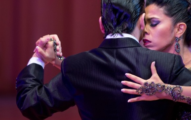 Colombian dancers Liliana Macchiabello and Alejandro Triunveri compete in the first round of the stage category at the World Tango Championship in Buenos Aires, Argentina, Thursday, Aug. 20, 2015. Hundreds of couples from around the world are competing in the championship's two categories: salon, and stage. (AP Photo/Natacha Pisarenko)