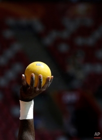 Grenada's Kurt Felix holds up his shot as he competes in the men's shot put decathlon at the World Athletics Championships at the Bird's Nest stadium in Beijing, Friday, Aug. 28, 2015. (AP Photo/Lee Jin-man)