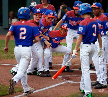 Bowling Green, Kentucky's Eli Burwash (2) trots home to greetings from his teammates after hitting a solo-home run off Taylors, South Carolina's Terrence Gist during the first inning of an United States elimination baseball game at the Little League World Series tournament in South Williamsport, Pa., Monday, Aug. 24, 2015. (AP Photo/Gene J. Puskar)