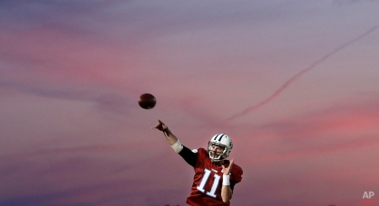 Tennessee Titans quarterback Alex Tanney passes during an evening practice at NFL football training camp Monday, Aug. 3, 2015, in Nashville, Tenn. (AP Photo/Mark Humphrey)