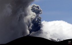 Ash and steam spew from the Cotopaxi volcano near Ticatilin, Ecuador, Friday, Aug. 21, 2015. Authorities said that residents living nearby could be threatened by fast-moving mud and rock flows if there is a major eruption of the Cotopaxi volcano. Its last major eruption was in 1877. (AP Photo/Dolores Ochoa)