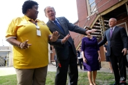 Former President George W. Bush dances with band director Asia Muhaimin as the band plays, during a visit to Warren Easton Charter High School in New Orleans, Friday, Aug. 28, 2015. Bush is in town to commemorate the 10th anniversary of Hurricane Katrina, which is Saturday. (AP Photo/Gerald Herbert)