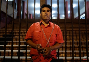 Anuncio Gisbreht, an Enhlet Indian, 43, symbolically chains himself to the gate of the National Republican Association's Party headquarters, in Asuncion, Paraguay, Wednesday, Aug. 19, 2015. Gisbreht claims that he had won the July 26 primary elections of the party for Mayor of the city of Loma Plata, and had later had been arbitrarily pushed aside with the election given to his rival Herbert Sunk. (AP Photo/Jorge Saenz)