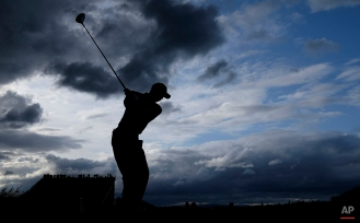 United States' Tiger Woods drives a ball from the 3rd tee during the second round of the British Open Golf Championship at the Old Course, St. Andrews, Scotland, Friday, July 17, 2015. (AP Photo/David J. Phillip)
