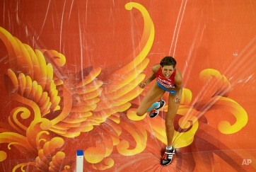 Croatia's Blanka Vlasic celebrates after clearing the bar in the women's high jump final at the World Athletic Championships at the Bird's Nest stadium in Beijing, Saturday, Aug. 29, 2015. (AP Photo/Wong Maye-E)