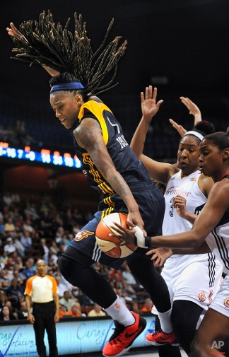 Indiana Fever's Shavonte Zellous grabs a loose ball against Connecticut Sun's Kelsey Bone, center, and Camille Little, right, during overtime of a WNBA basketball game, Tuesday, July 28, 2015, in Uncasville, Conn. Indiana won 75-73. (AP Photo/Jessica Hill)