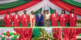 Burundi's President Pierre Nkurunziza, center, is sworn in for a third term at a ceremony in the parliament in Bujumbura, Burundi Thursday, Aug. 20, 2015. Without any fanfare or even a public announcement beforehand, Nkurunziza was sworn in for a third term on Thursday in this central African country which has been plagued by political violence that has left more than 100 people dead and tens of thousands of refugees. (AP Photo/Gildas Ngingo)